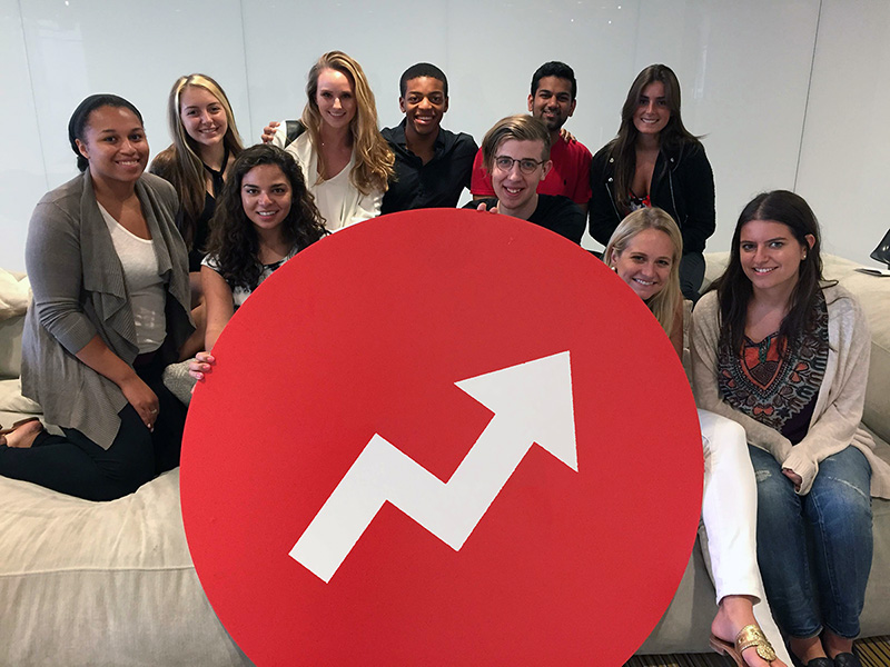 Interns posing with an enormous trending badge